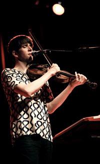 Pallett on vocals & violin