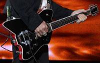 Gibbons' fingers across the frets