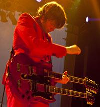 OK Go play a double-neck guitar