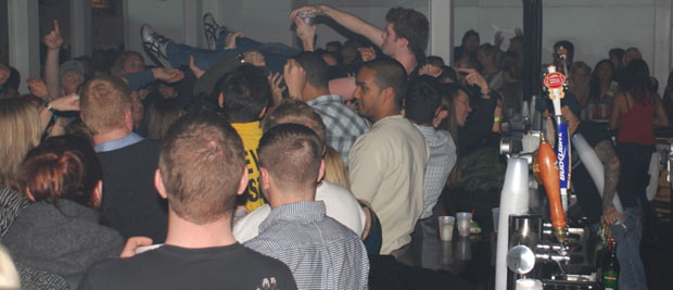 crowdsurfing to the bar