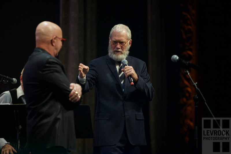 David Letterman presenting childhood harmonica to Paul Shaffer