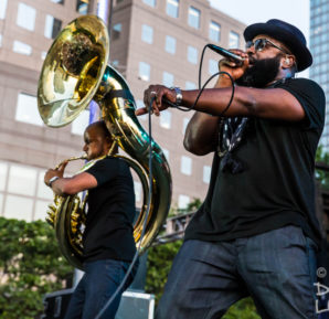 """Tuba Gooding Jr."" aka Damon Bryson onstage with The Roots' Black Thought at Lowdown Hudson Music Fest in Manhattan."