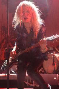 Mosshart on guitar
